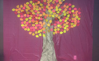 Caliente Construction's Tree of Gratitude with colorful hand-written notes as leaves.